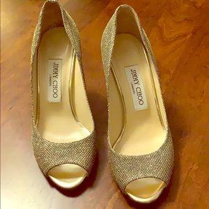 Jimmy Choo beautiful gold shoes.